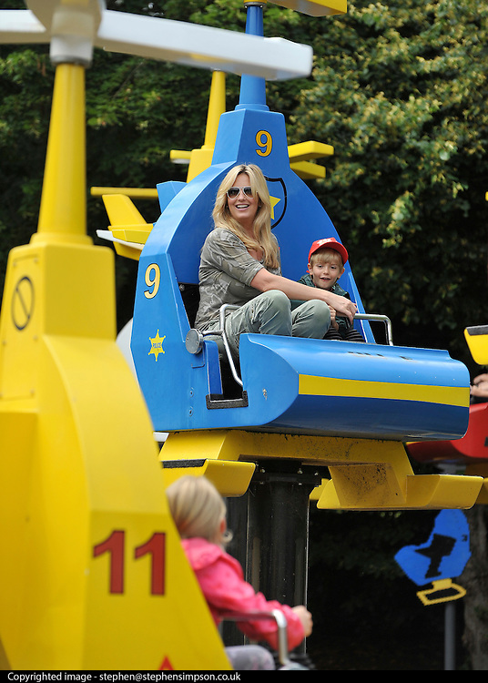 © licensed to London News Pictures. WINDSOR, UK.  09/07/11. Penny Lancaster with her son Alastair (blue helicopter)  and her niece Raphaell (yellow helicopter) on the Chopper Squadron ride at Legoland Windsor, today 09 July 2011. Penny Lancaster is married to Rod Stewart.  PERMISSION GRANTED BY PENNY LANCASTER FOR CHILDREN TO BE IDENTIFIED. Mandatory Credit Stephen Simpson/LNP