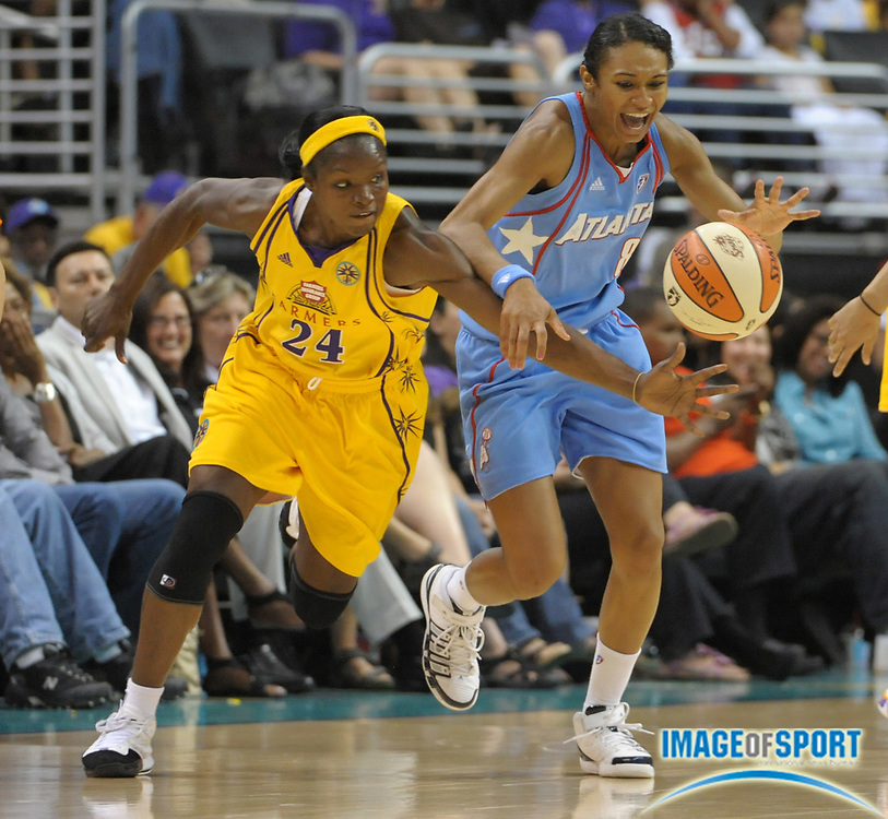 May 30, 2010; Los Angeles, CA, USA; Los Angeles Sparks guard Marie Ferdinand-Harris (24), left, and Atlanta Dream forward Iziane Castro Marques (8) scramble for the ball in the second half at the Staples Center. The Dream defeated the Sparks 101-82.