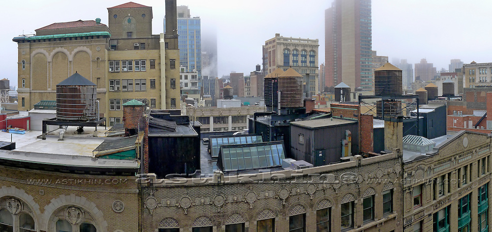 Old water tanks on roofs of New York City.