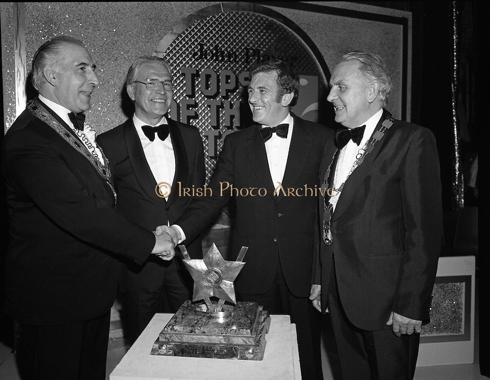 Tops of the Town Final.   (N79)..1981..31.05.1981..05.31.1981..31st May 1981..The John Player sponsored Tops Of The Town competition had its final tonight in the Gaiety Theatre, Dublin.The overall winners were the Limerick Insurances Group...Picture shows Mr Douglas Howell,(2nd rt),producer of the Limerick Insurances show,winners of the John Player Tops of the Town final at the Gaiety Theatre, Dublin, being congratulated by Clr Edward Turner,Chairman, Strabane District Council. Clr Turner represented St Joseph's Youth Club, Strabane who were runners up in the final. Also included are Mr Oliver Casey, Managing Director John Player and The Lord Mayor of Limerick, Clr Clem Casey.