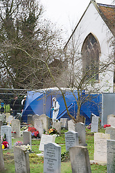 © London News Pictures. 18/12/2013 . Didcot, UK. A Police forensics team examining an area in a graveyard at All Saints Church in Dicot where police have started searching in connection with the disappearance of teenager Jayden Parkinson who has been missing since December 3rd. 22 year-old Ben Blakeley has been charged with the murder of 17-year-old Jayden. Photo credit : Ben Cawthra/LNP