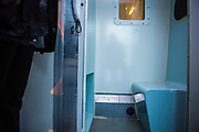 Inside a Geoamy prisoner escort van arriving at HMP/YOI Portland, a resettlement prison with a capacity for 530 prisoners. Dorset, United Kingdom.