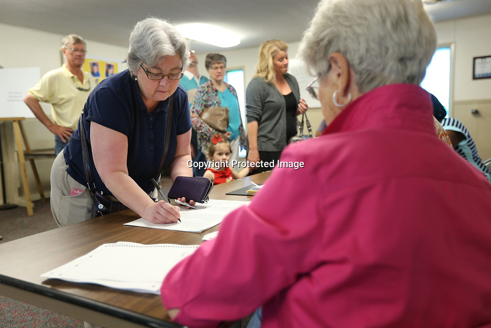Tammie Wise signs in before casting her vote for the City Council Ward 6 race at the precinct 10 location at Wildwood Baptist Church in Tupelo Tuesday morning. The precinct had 130 votes by 10:00.