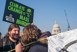 November 17, 2018 - London, United Kingdom - Protesters from the embryonic Extinction Rebellion movement blocked five bridges in central London. Demonstrating against government inaction over climate change and species extinction, they vowed to keep up their rebellion until action is taken. Numerous arrests took place as police cleared protesters from the bridges. (Credit Image: © Rob Harbinson via ZUMA Wire)