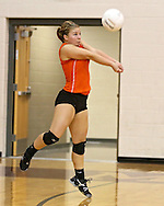 Solon's Rylee Smith (4) digs the ball during the WaMaC Tournament semifinal game at Mount Vernon High School in Mount Vernon on Thursday October 11, 2012. Solon defeated Mount Vernon 26-24, 25-22.