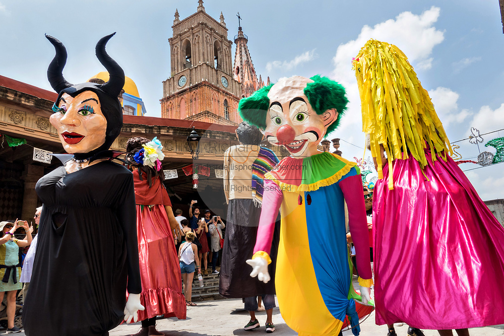 Giant papier mâché puppets called mojigangas dance in front of the Parroquia de San Miguel Arcangel church during a children's parade celebrating Mexican Independence Day celebrations September 17, 2017 in San Miguel de Allende, Mexico.
