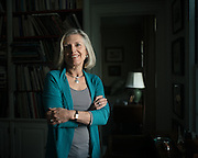 "BIRMINGHAM, AL – NOVEMBER 3, 2016: Louise McPhillips, 62, sits at home where she manages her own residential architecture firm. As a seventh grade student, McPhillips remembers taking a career aptitude test that pointed her toward careers requiring proficiency in mathematics, such as architecture. When her counselor told her women couldn't be architects because they aren't good at math, she listened. ""I thought he was imparting great wisdom on me, trying to save me this heartache from not being able to do it,"" McPhillips said. As a result, she went to college and majored in historic preservation instead. ""I was a senior in college before I even thought about going back to graduate school for architecture. And it turns out I can do math, thank you very much."" McPhillips received her masters degree in architecture from the University of Virginia in 1980, studied further in Vincenza, Italy, and later worked as an apprentice for KPS group in Birmingham, Alabama before starting her own practice in 1984. CREDIT: Bob Miller for The New York Times"