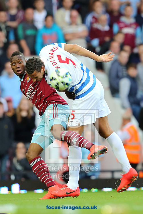 Diafra Sakho of West Ham United and Rio Ferdinand of Queens Park Rangers battle during the Barclays Premier League match at the Boleyn Ground, London<br /> Picture by Richard Calver/Focus Images Ltd +447792 981244<br /> 05/10/2014