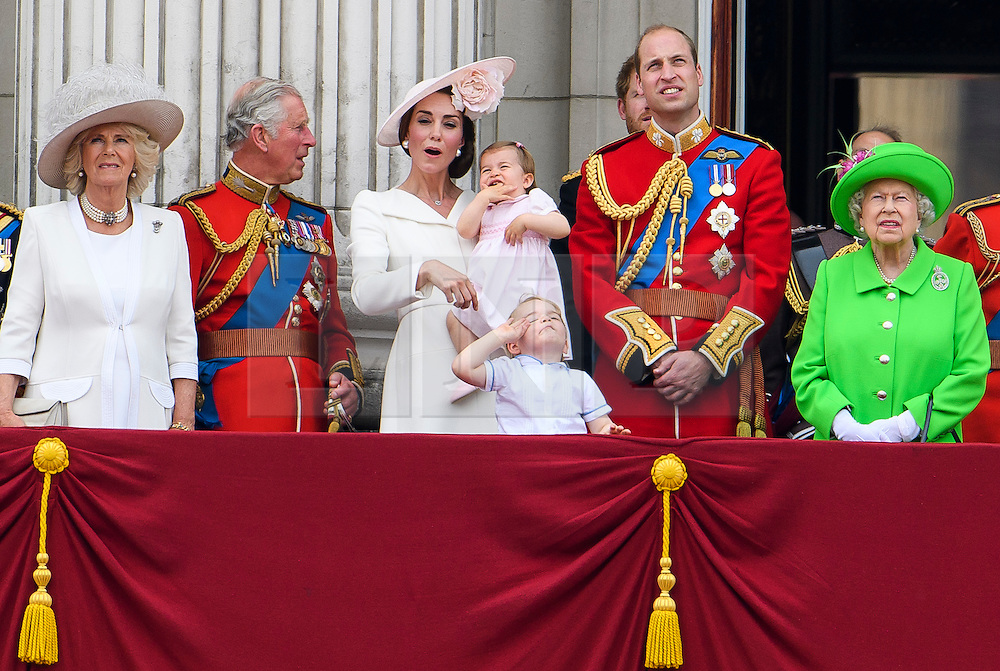 © Licensed to London News Pictures. 11/06/2016. London, UK. CAMILLA DUCHESS OF CORNWALL, CATHERINE, DUCHESS OF CAMBRIDGE, PRINCESS CHARLOTTE, PRINCE GEORGE, PRINCE WILLAM and QUEEN ELIZABETH II  on the balcony of Buckingham Palace, during the Trooping The Colour ceremony in London. This years event is part of a weekend of celebration to mark the 90th birthday of Queen Elizabeth II, who is Britain's longest reigning monarch. Photo credit: Ben Cawthra/LNP