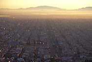 © Mark Henley / Panos Pictures..Mexico City, MEXICO...Aerial view of urban sprawl in the Nezahualeuyotl area of the city, with the remains of a once-great lake in the distance.