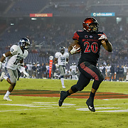 18 November 2017:  The San Diego State football team hosts Nevada Saturday night. San Diego State Aztecs running back Rashaad Penny (20) breaks away from the Nevada defense for a touchdown run in the fourth quarter. The Aztecs beat the Wolf Pack 42-23 at SDCCU stadium. <br /> www.sdsuaztecphotos.com