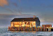 "Large black & white portraits of Portuguse women by Provincetown photographer Norma Holt are mounted on this Fishermen's Wharf building. The installation, called ""They Also Faced the Sea"", was a concept of Ewa Nogiec, the Polish painter and photographer, who has lived on Cape Cod since 1983."
