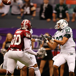 December 18, 2010; New Orleans, LA, USA; Ohio Bobcats wide receiver Steven Goulet (87) catches a touchdown over Troy Trojans cornerback Ladarruis Madden (30) during the first quarter of the 2010 New Orleans Bowl at the Louisiana Superdome.  Mandatory Credit: Derick E. Hingle