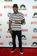 Actor Hassan Johnson poses on the red carpet at the premiere of the movie Staten Island Summer at Sunshine Cinema, Tuesday, July 21, 2015, in New York.  The new comedy debuts on Netflix on July 30, 2015 and is available for Digital download. (Photo by Diane Bondareff/Invision for Paramount Pictures/AP Images)