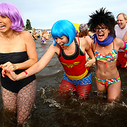 Participants brave the 49 degree Lake Washington water during the annual Polar Plunge at Matthews Beach in Seattle on Sunday, January 1, 2011. The annual New Year tradition saw one of its largest turnouts as people waded, ran and dove into the cold water. (Photo by Joshua Trujillo, seattlepi.com)
