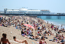 © Licensed to London News Pictures. 30/06/2015. Brighton, UK. Thousands of people take advantage of the hottest day of the year so far by relaxing and sunbathing on Brighton beach, today June 30th 2015. Photo credit : Hugo Michiels/LNP
