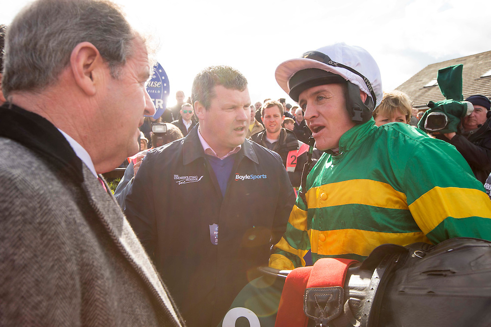 Horse Racing - Fairyhouse Easter Festival, Monday 28th March 2016<br /> Barry Geraghty talks to J.P McManus and Gordon Elliott after Sutton Place won the Rathbarry & Glenview Studs Novice Hurdle<br /> Photo: David Mullen /www.cyberimages.net / 2016