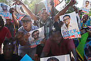 Dar es Salaam, Tanzania - 10/27/15 - Supporters of opposition party Chadema wait for parliamentary results outside a polling station in Dar es Salaam, Tanzania on October 27. Chadema candidate Halima Mdee was declared winner of the Kawe parliamentary seat by the National Electoral Commission.  Photo by Daniel Hayduk