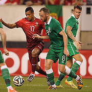 Nani, Portugal, is challenged by David Meyler, Ireland, during the Portugal V Ireland International Friendly match in preparation for the 2014 FIFA World Cup in Brazil. MetLife Stadium, Rutherford, New Jersey, USA. 10th June 2014. Photo Tim Clayton