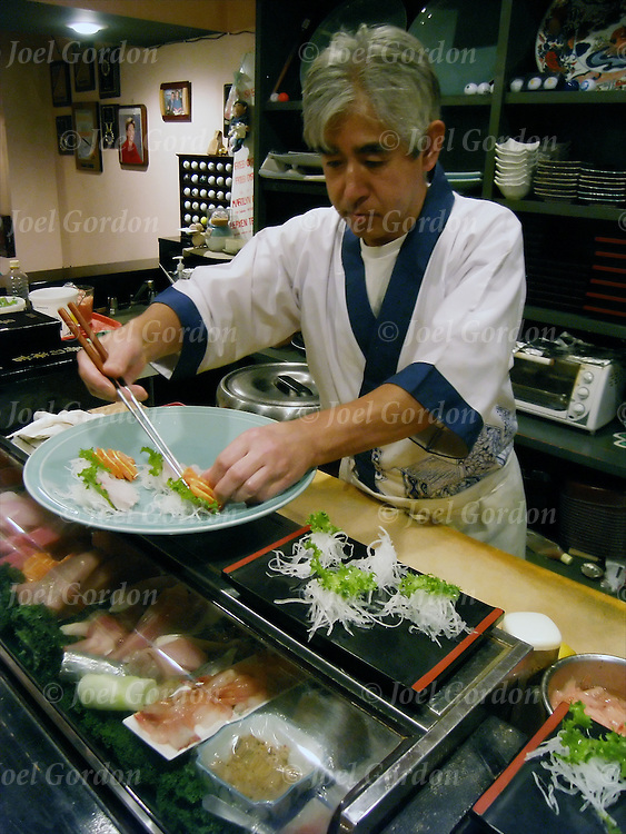 Shumi Japanese Restaurant, Sushi Chief preparing large dish of sushi