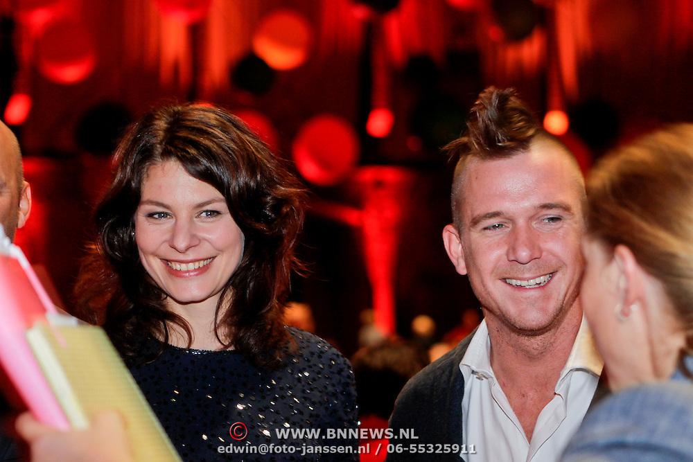 NLD/Amsterdam/20111012 - Premiere Patatje Oorlog, Rifka Lodeizen en Johnny de Mol