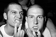 Two Skinheads, showing lip tattoos, Brighton, 2014.