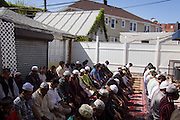 Islamic prayers on a Friday afternoon at the Muhammadi Center on 72nd Street, led by Imam Qayyoom.
