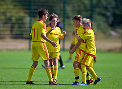 NEWPORT, WALES - Wednesday, July 25, 2018: Josh Carey celebrates scoring the first goal with Lewis Cousins, Kyle Kenniford and Jordan James during the Welsh Football Trust Cymru Cup 2018 at Dragon Park. (Pic by Paul Greenwood/Propaganda)