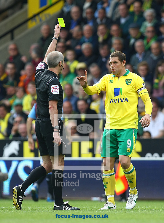 Picture by Paul Chesterton/Focus Images Ltd.  07904 640267.13/05/12.Grant Holt of Norwich gets a yellow card from Referee Martin Atkinson during the Barclays Premier League match at Carrow Road Stadium, Norwich.
