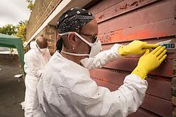 Homes for Haringey community clean up of housing estate garages, North London UK