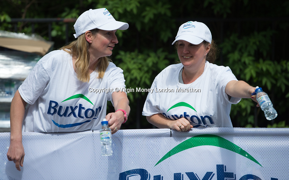 Volunteers hand out Buxton water at Mile 22 during The Mass Event. The Virgin Money London Marathon, 23rd April 2017.<br /> <br /> Photo: Joe Toth for Virgin Money London Marathon<br /> <br /> For further information: media@londonmarathonevents.co.uk