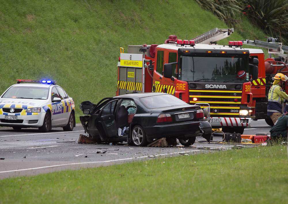 Emergency crews are attending a two car head on crash on SH29 at Maungatapu,Tauranga, New Zealand, Monday, January 11, 2016. Credit:SNPA / Cameron Avery
