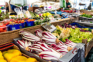 Vegetables for sale at Campo de Fiori in Rome, Italy, an outdoor market. Radicchio, lettuce, tomatoes, zucchini on display.