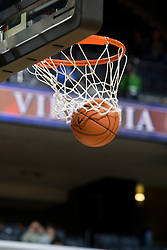 A basketball falls through the net.  The Virginia Cavaliers women's basketball team defeated the Morehead State Eagles 88-43 at the John Paul Jones Arena in Charlottesville, VA on February 4, 2008.