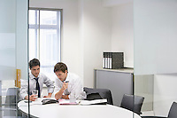 Two businessmen in office having conference call