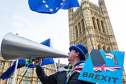 London, UK. 12th February, 2019. Anti-Brexit protester Steve Bray of SODEM (Stand of Defiance European Movement) yells 'Stop Brexit' outside Parliament.