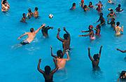 Water polo players stretch for the ball in the water during an August heatwave, on 20th August 1995, at Brockwell Lido, Herne Hill, London, England.