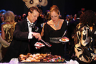 Andrew & Jennifer Reitz visit the dessert table during the VIP reception following the 10th Anniversary Concert at the Schuster Center in downtown Dayton, Friday, March 1, 2013.