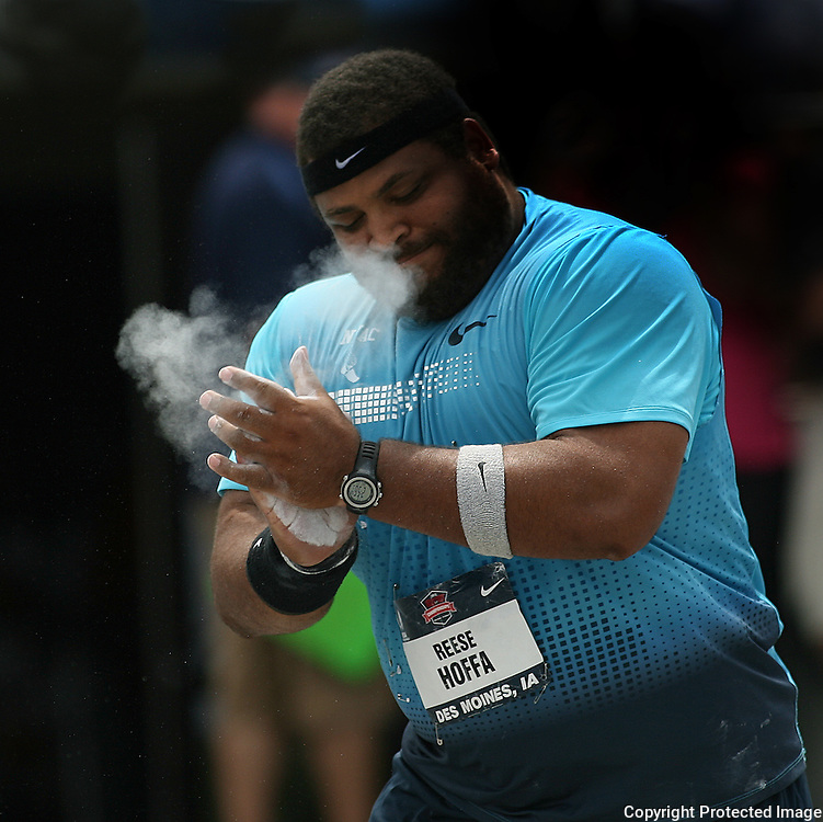 HOFFA - 13USA, Des Moines, Ia. - Reece Hoffa slaps his hands together after a good throw in the shot put competition.  Hoffa placed second.  Photo by David Peterson