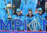 Eoin Morgan of England, Jos Buttler of England and Joe Root of England celebrate with Cricket World Cup after becoming World Champions during the ICC Cricket World Cup 2019 Final match between New Zealand and England at Lord's Cricket Ground, St John's Wood, United Kingdom on 14 July 2019.