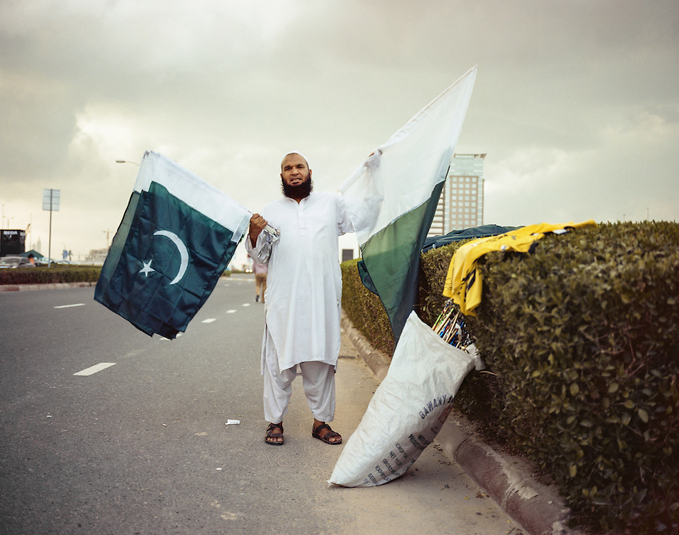 APRIL 2016: Street seller with Pakistani flags to support the cricket team in Sports City