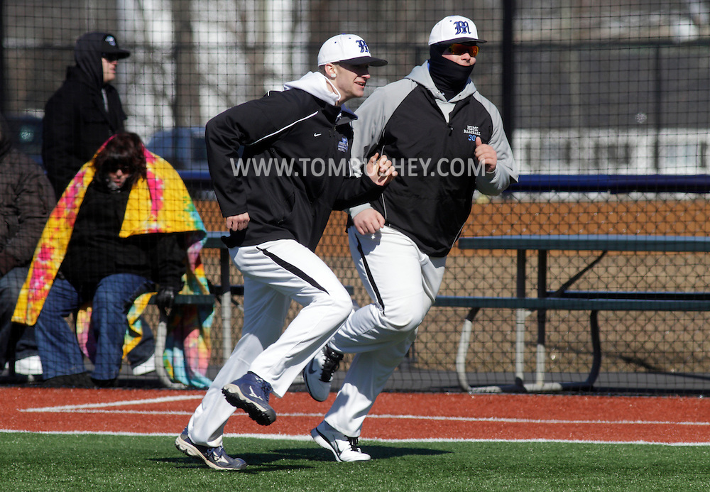 Chester, New York  - Two Mount Saint Mary College baseball players run in the outfield between innings of a game against SUNY Brockport at The Rock Sports Park on Feb. 26, 2012.