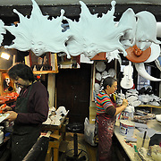 Two artisans works inside their workshop at Mascareri in Venice. Artisans, masks and costumes makers are getting ready ahead of Venice Carnival 2013