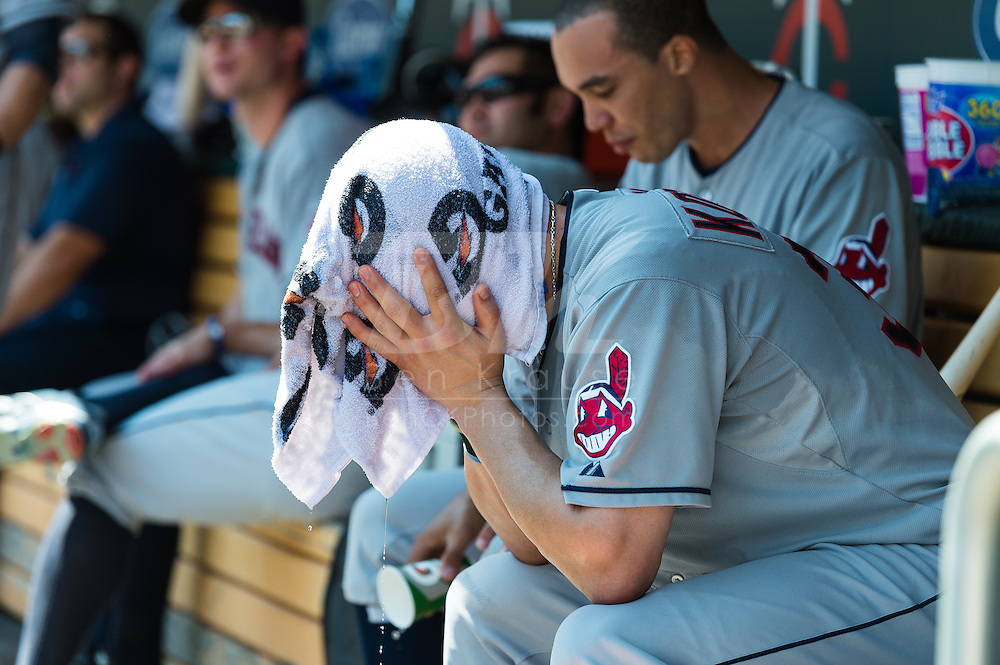 Cleveland Indians 1st baseman Casey Kotchman holds a wet towel over his head in the dugout during a game against the Minnesota Twins at Target Field in Minneapolis, Minnesota on July 29, 2012.  The Twins defeated the Indians 5 to 1.  © 2012 Ben Krause