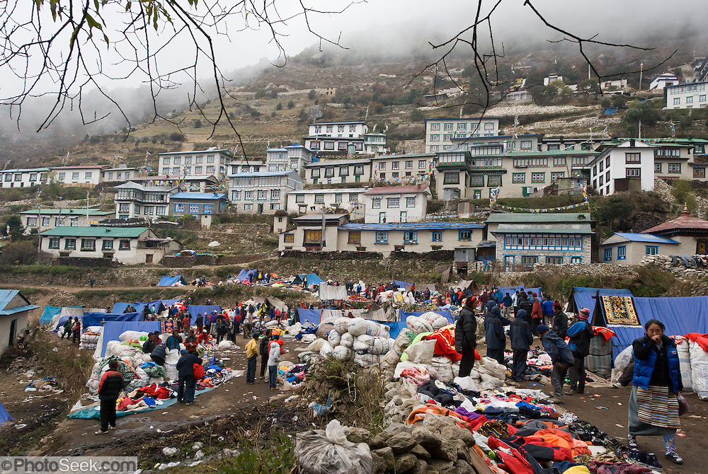 Traders sell merchandise every day at the Tibetan Market in the town of Namche Bazaar (or Nemche Bazaar or Namche Bazar) ) at 11,220 feet elevation, in Sagarmatha National Park, in the Khumbu region of Nepal. Sagarmatha National Park (created 1976) was honored as a UNESCO World Heritage Site in 1979.