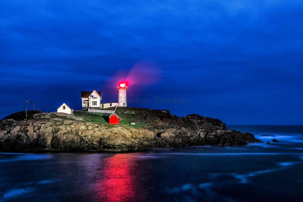 Nubble Lighthouse at night, Cape Neddick, York, Maine, USA.