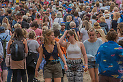 People flood into the Arena and work out where to go as the gates open in the morning - The 2017 Latitude Festival, Henham Park. Suffolk 15 July 2017