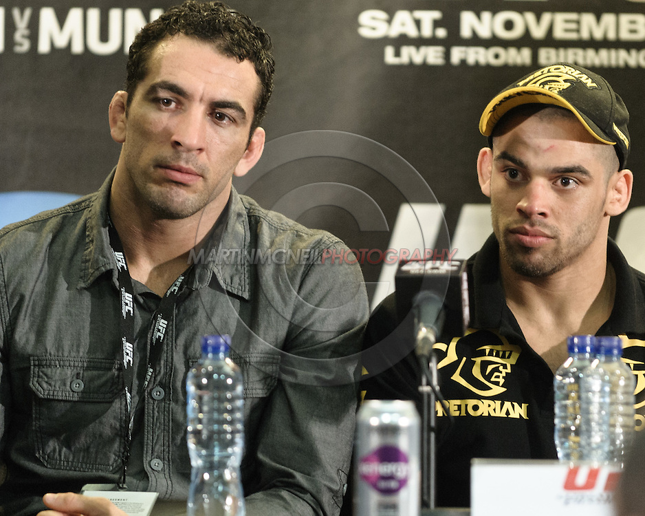 BIRMINGHAM, ENGLAND, NOVEMBER 5, 2011: Braulio Estima (left) translated for Renan Barao (right) during the post-fight press conference for UFC 138 inside the LG Arena on November 5, 2011.