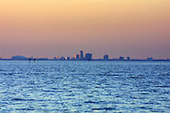 The sun sets on the city of St. Petersburg, Florida viewed from across Tampa Bay.