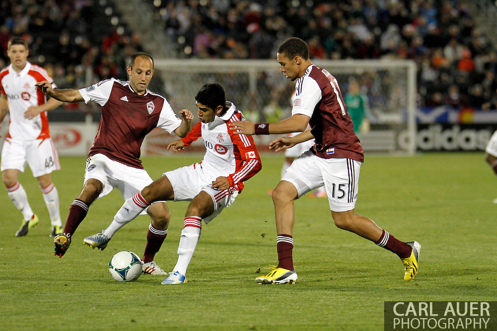 May 4th, 2013 Commerce City, CO - Toronto FC forward Justin Braun (17) attempts to keep the ball away from Colorado Rapids defender Chris Klute (15) and midfielder Nick LaBrocca (2) in the second half of the MLS match between the Toronto FC and the Colorado Rapids at Dick's Sporting Goods Park in Commerce City, CO